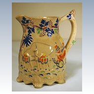 19th Century British Drabware Relief Molded Jug, Elephants & Camels