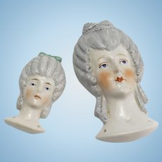 Two Vintage Bas Relief Doll Heads