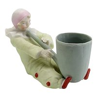 Very Pretty All Bisque Figure of Clown and Pipe Piano Baby