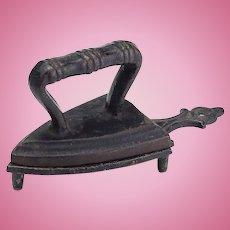 Vintage Cast Iron Miniature Sad Iron on Trivet
