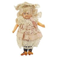 Vintage Celluloid Mignonette Doll in Lovely Outfit