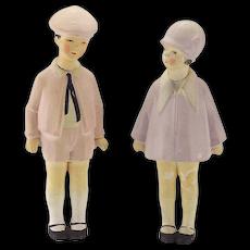Pair of Antique German  All Bisque Dolls