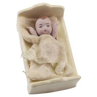 Antique Tiny Bisque Baby doll in Bisque Bed
