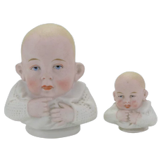Two Matching Bisque Doll Heads