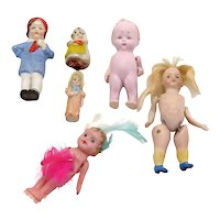 Six Antique and Vintage all Bisque Dolls