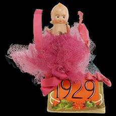 Vintage Celluloid Tiny Kewpie with 1929 Calendar