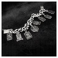 Marked 900 Silver Heraldic Charm Bracelet