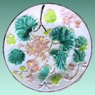 Vintage Majolica Plate with Pink Geraniums and Green Leaves