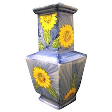 Interestingly Shaped Pottery Vase with Bright Sunflowers