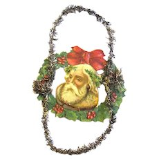 Victorian Scrap and Tinsel Christmas Ornament of Santa's Head in Wreath