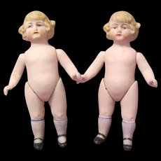 Pair of Tiny Antique Twin All-bisque Dolls