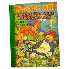 """Raggedy Ann Helps Grandpa Hoppergrass"", 1940 board Book by Johnny Gruelle"