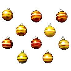 A Golden Cache of Vintage Shiny Brite Striped Mercury Glass Balls