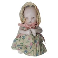"German 4"" All Bisque Baby with Molded Bottle"