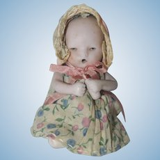 """German 4"""" All Bisque Baby with Molded Bottle"""