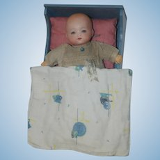 Amberg Dolls Newborn Baby in tagged Dress with Cradle and Linens