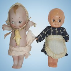 Vintage Kewpie Trio - one All Bisque, one Carved, and one Celluloid Kewpies
