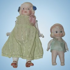 Two All Bisque Dolls with Molded Hair Bows - Japan
