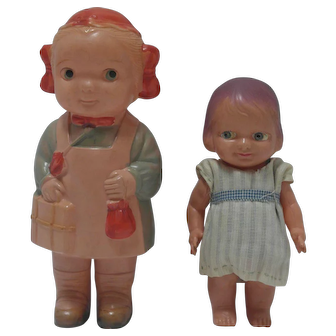 Two Celluloid Dolls - one packed for a trip to Grandma's - Japan