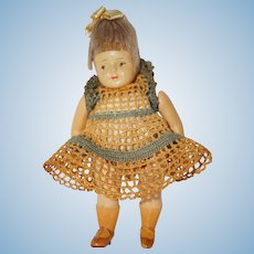 "4 1/2"" German Celluloid ""Helmet"" Doll in Crocheted outfit"