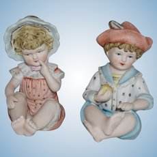 Vintage Porcelain Piano Baby Pair