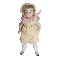 "German 3 1/2"" All Bisque Doll in Crocheted Outfit"