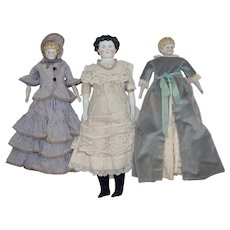 Three Antique Blue Eyed Chinas - all in vintage clothing