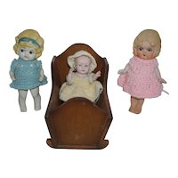 German All Bisque Baby in Cradle with Two All Bisque Japan Sisters