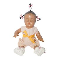 """11"""" Composition Ethnic Doll in Pink Romper"""