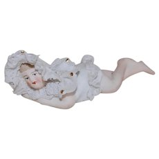 Bisque Lacey Bonnet Reclining Piano Baby