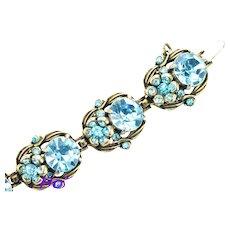 36481a - Signed Hollycraft 1954 Aqua/Teal Color Stones Flower 7 Section Bracelet