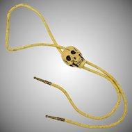 Circa 1985 Detailed Human Skull Bolo Tie w/ Brass Tips