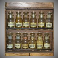 1970s Set of 12 Apothecary Glass Spice Jars w/ Original Wood Cabinet