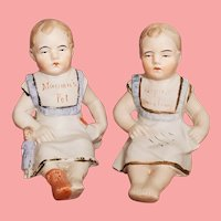 """Pair of Antique German Bisque Piano Baby Figurines """"Mama's Pet"""" & """"Papa's Darling"""""""