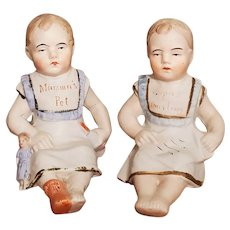 "Pair of Antique German Bisque Piano Baby Figurines ""Mama's Pet"" & ""Papa's Darling"""
