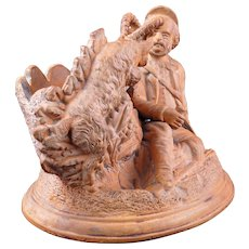 Fired clay cigar and match holder with goat and hunter figure late 19th century