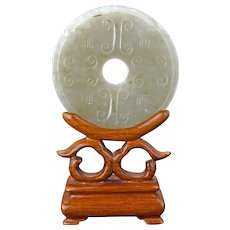 Chinese pale green jade bi disc with stand 20th century