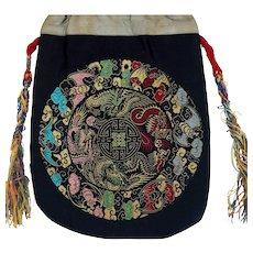 Chinese brocade fabric silk purse with dragon and bat design circa late 19th century