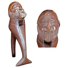 Hand carved wood nutcracker of a fisherman with one handle a fish tail late 19th century