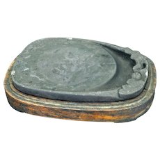 Chinese ink stone with a lotus design in a tropical hardwood wood holder late 19th century