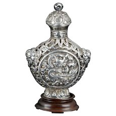 Antique Sino Tibetan repousse silver snuff bottle with dragon motif 19th century
