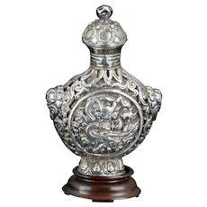 Antique Sino Tibetan repousse silver snuff bottle with dragon motif 19th century