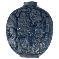 Antique Chinese black lacquer snuff bottle with intricate carving of the eighteen Lohan 19th century