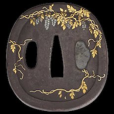 Japanese cast iron Tsuba with inlays of wisteria 19th century