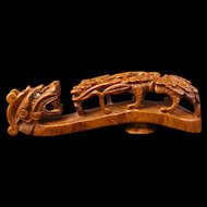 Chinese elm burl wood child's belt hook with dragon and cloud motif 19th century