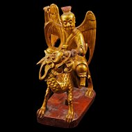 Chinese gold lacquer painted wood carving of an immortal riding a Chi lin 19th century