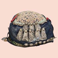 Tibetan handmade fabric spirit hat decorated with metal Buddha figures early 20th century