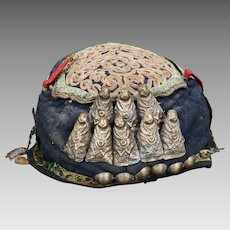 Tibetan handmade fabric spirit hat decorated with metal Buddha figures early 20th century