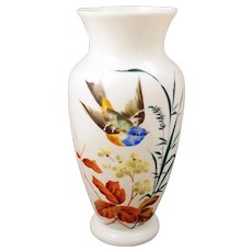 Large white Bristol glass vase with a hand painted design of a flying bird, grass and a flowering branch circa 1900