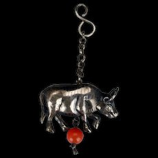 Antique Chinese silver jewelry figural pendant in the shape of a cow with carnelian bead 19th century